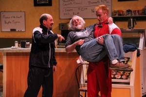 Duane Sawyer as Max Tarasov, Charlie Ferrie as Arthur Przybyszewski, and Sean Coffman as Kiril Ivakin in OpenStage Theatre's production of Superior Donuts by Tracy Letts. Photo by Joe Hovorka